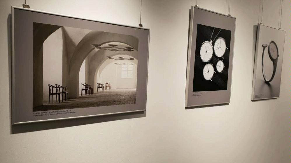 Black and white photo of three pictures hanging an the wall - the elements of the exhibition